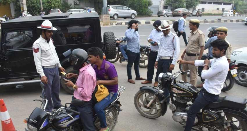 gujrat moter vehicle act hike down