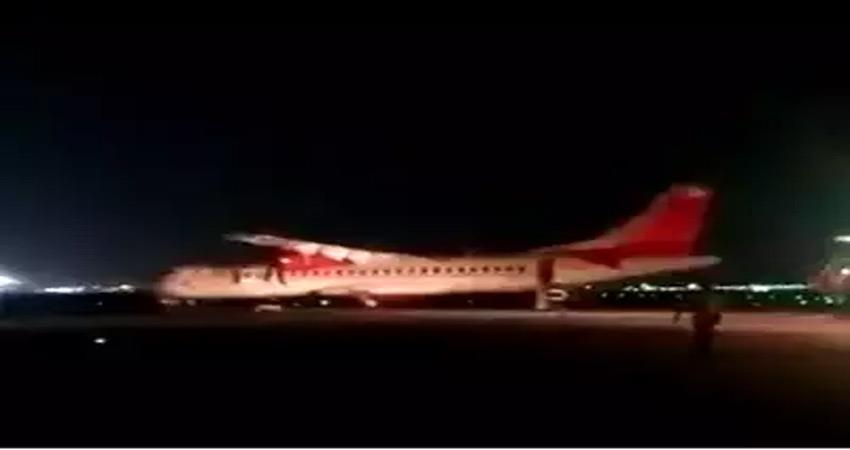 alliance air flight catches fire as it makes emergency landing in delhi