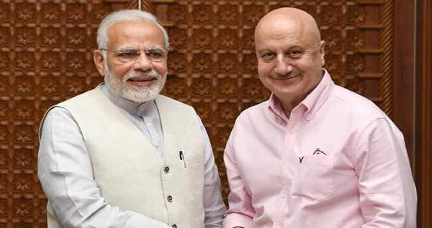 anupam kher gift his  autobiography to pm modi