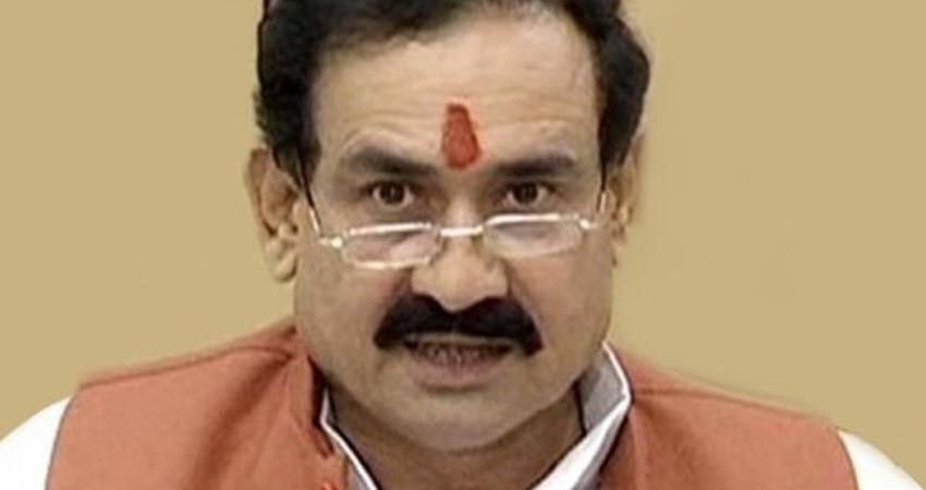 mp home minister narottam mishra said i not wear masks congress raised questions rkdsnt