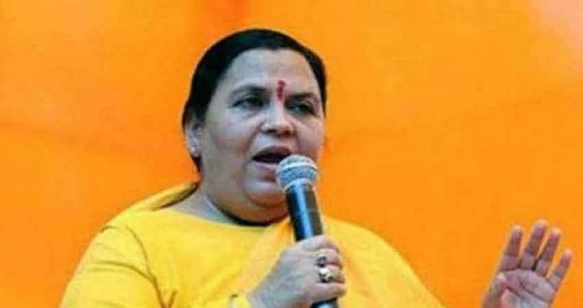 former union minister uma bharti criticized lawyer rajiv dhawan for tearing the map