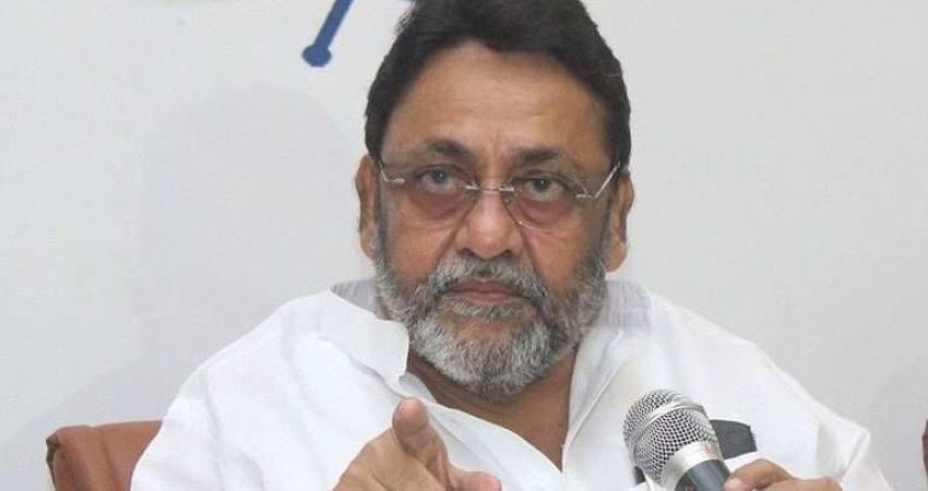 pawar shah meeting denied by ncp nawab malik attacked bjp rkdsnt